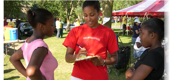 Medical student conducting a health survey in an underserved community in Madison, Wisconsin.  This program was organized through a partnership between the Allied Wellness Center and the Office of Community Service Programs at the UW School of Medicine and Public Health.  Website: http://www.med.wisc.edu/education/md/community-service/main/148